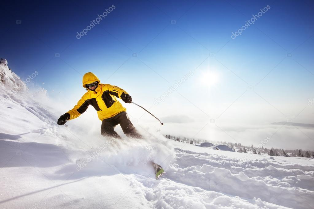 Skier rides on the slope