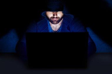 Man sits at computer