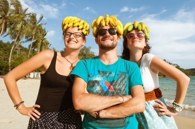 friends with bananas on their heads