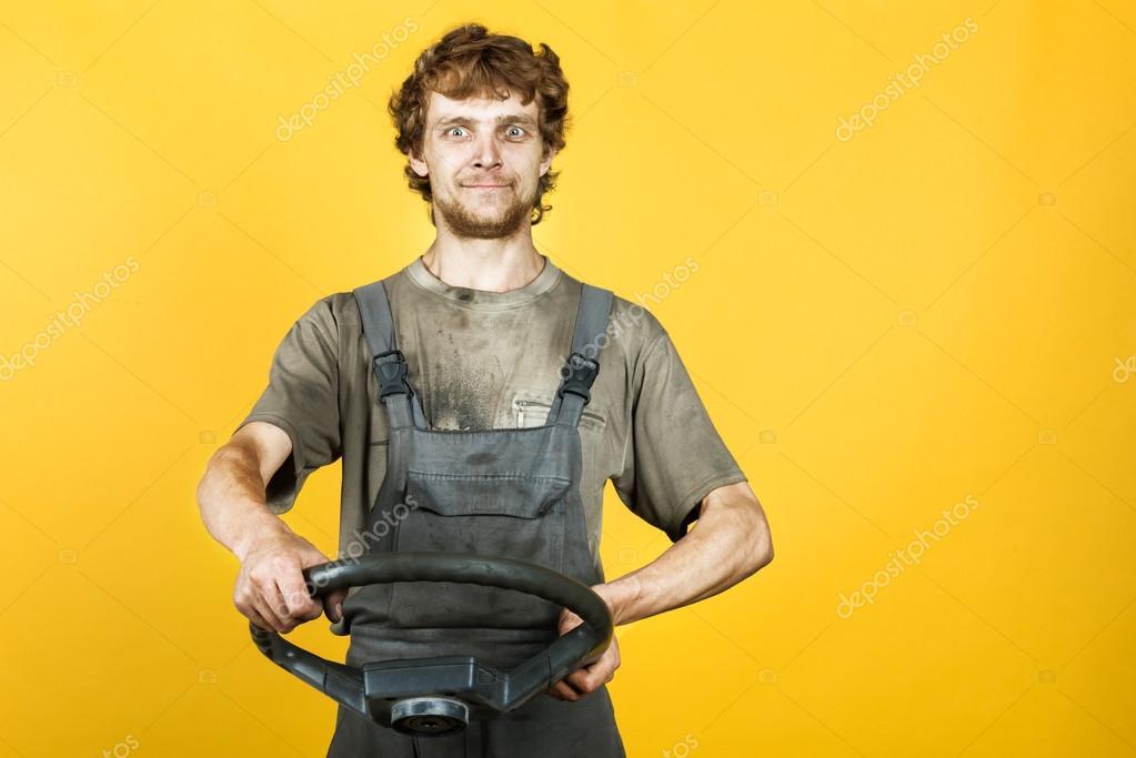 Man dressed in dirty boiler suit