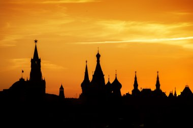 Silhouettes of Moscow Kremlin at Red square on sunset