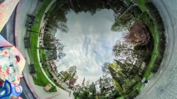 People Walk by Footpath Park Alley Video 360 vr Panoramic View of Square Sculpture is in the Middle of the Park Paving Stones Green Lawns Opole Poland