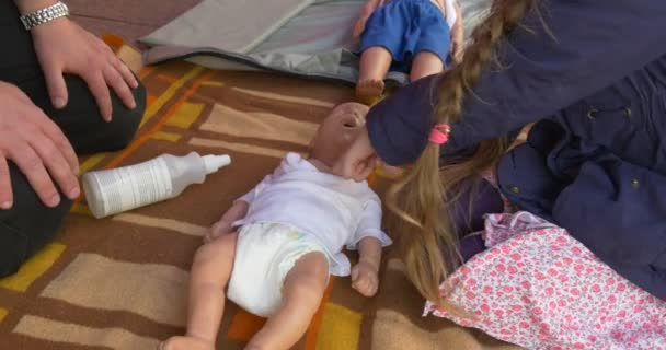 Three Training Dummies Lie Before the Little Girl