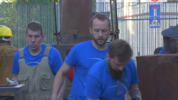 Employees of Workshop Repair Industrial Furnace During Carrying Out of Festival of the Raised Temperatures in Wroclaw