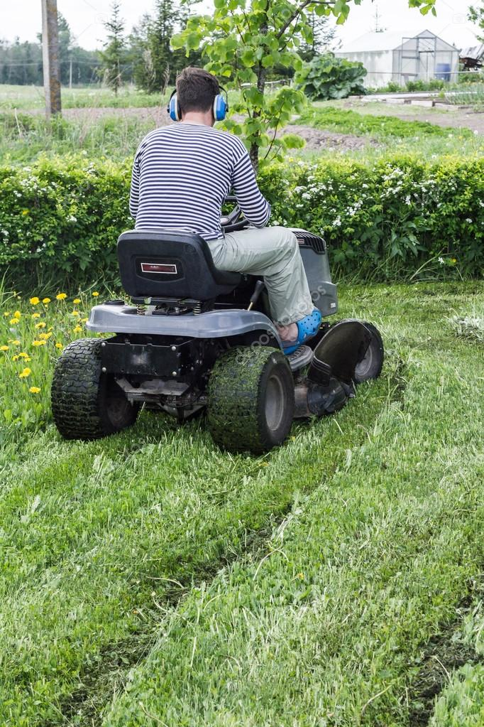 The man mows a grass