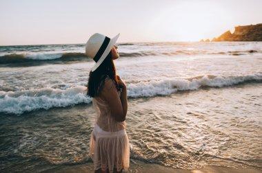woman walks along beautiful seashore