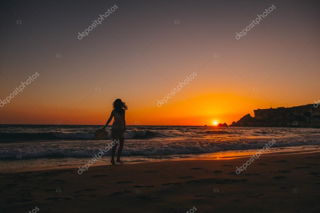 silhouette of girl at sunset