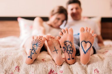 close up of feet with drawings