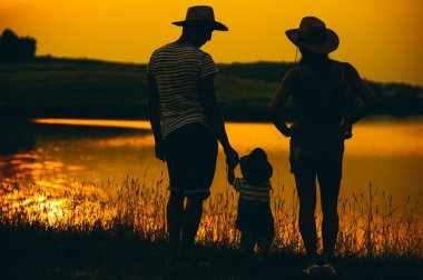 Happy family together at sunset
