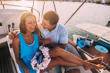 smiling couple at yacht