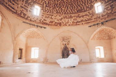 couple in ancient temple hall