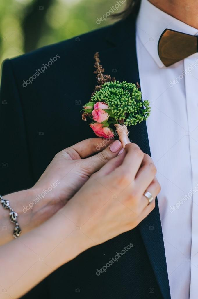 wooden bow tie and boutonniere