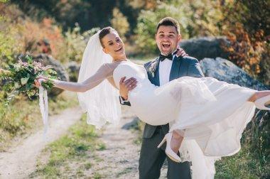 Young wedding couple walking