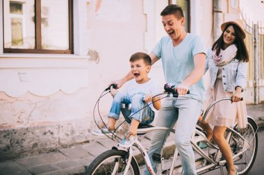 Family having fun on double bike