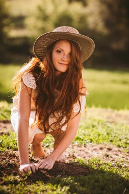 young redhead woman in countryside