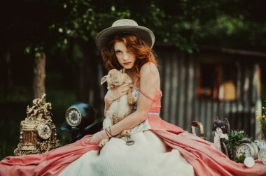 beautiful redhead girl with rabbit