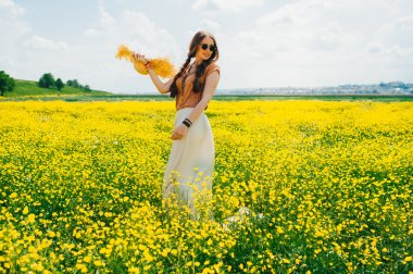 Romantic hippie girl on a field