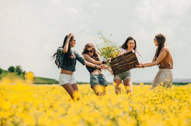 Four beautiful hippie girls