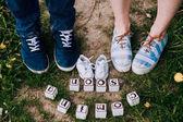 Fotografie legs of couple on green grass