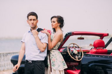 Young couple with vintage car