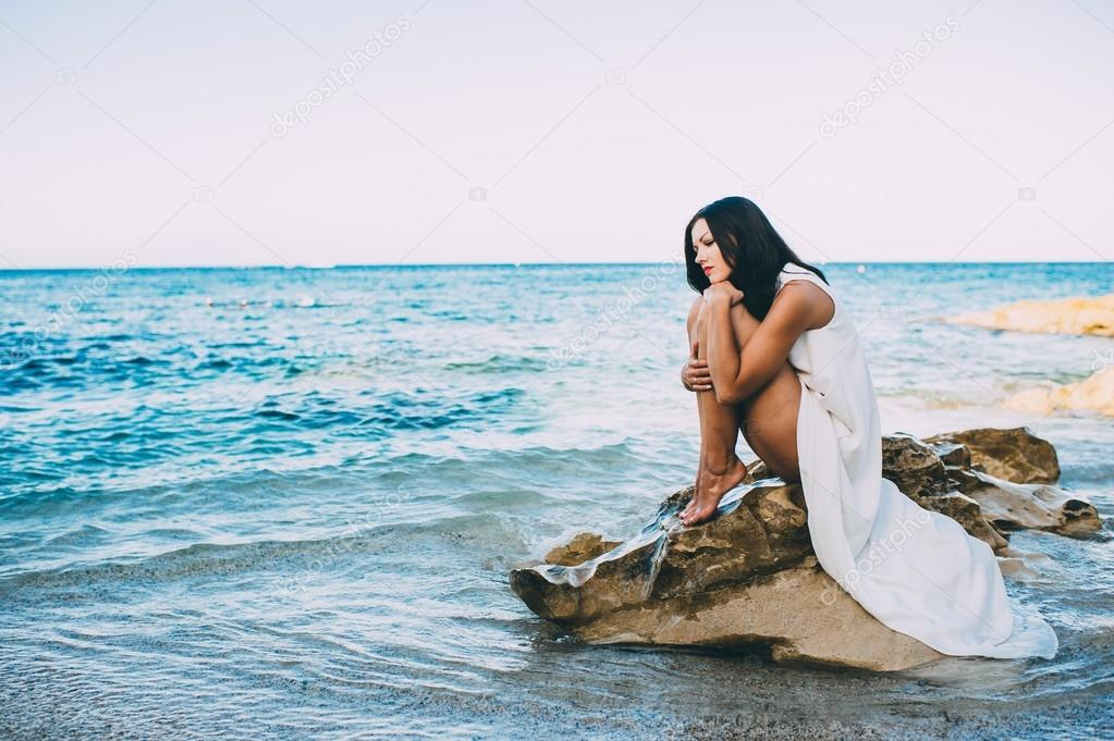 beautiful girl relaxes near sea