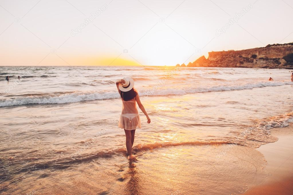 woman walks along beautiful seashore