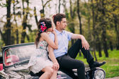 Fotografie Young couple in vintage car