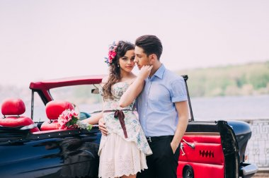 Young couple in vintage car