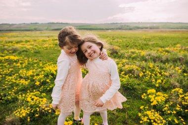 little twin sisters