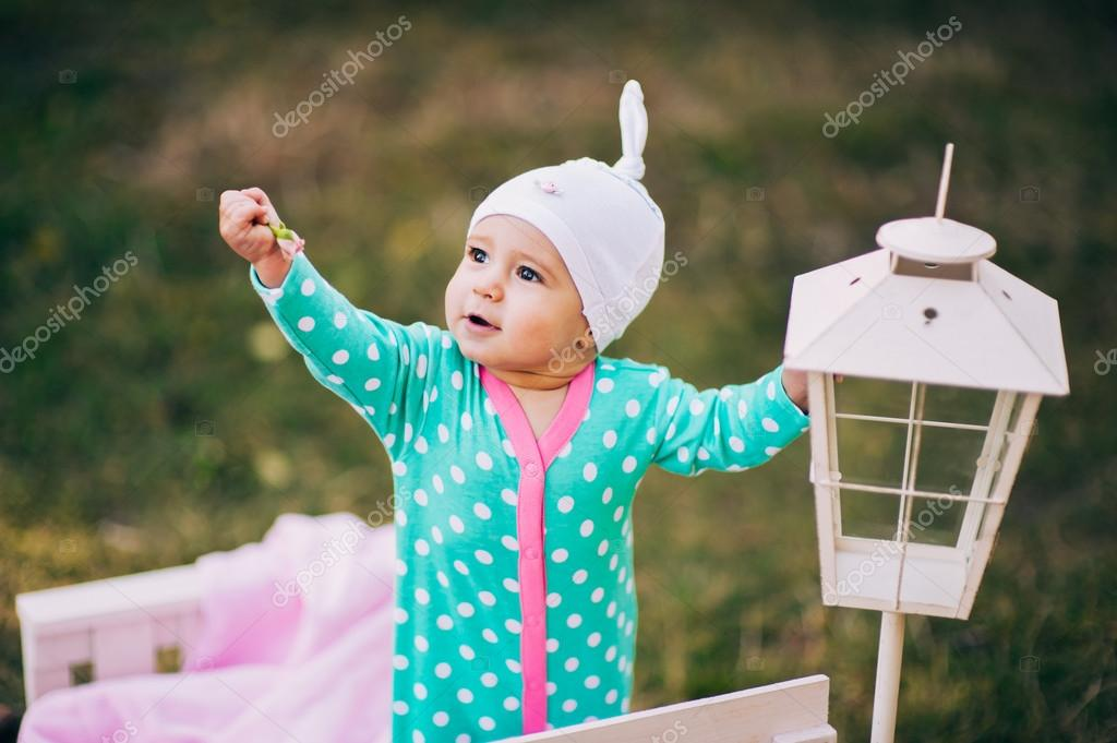 Little beautiful infant girl in park