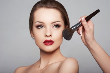 young girl with doing make up
