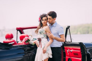 girl with a guy in a retro car