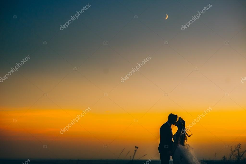 silhouette of couple with sunset