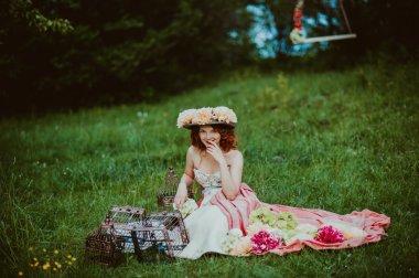 girl with empty birdhouses  outdoors