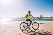 Fotografie carefree woman with bicycle riding