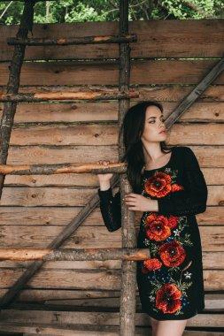 woman wearing national ukrainian clothes