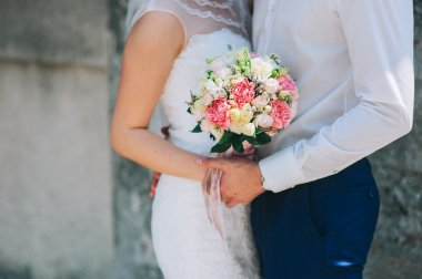 Woman holding  flowers bouquet