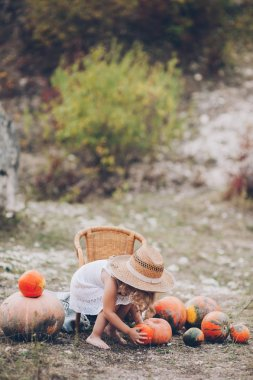 Charming little girl in a straw hat