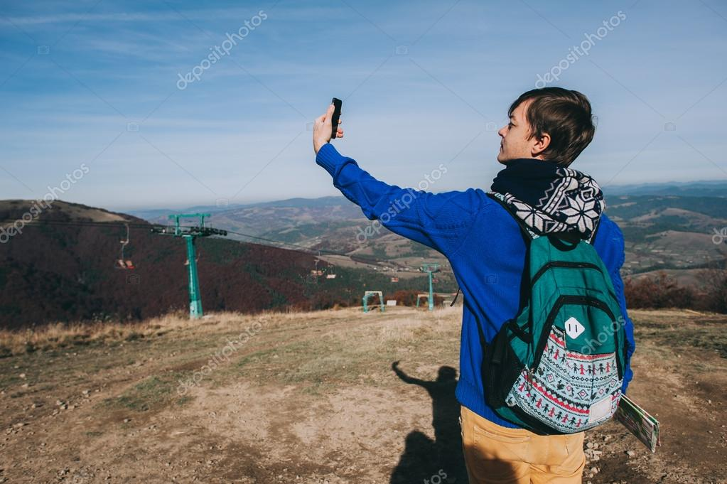 hipster taking photo by smart-phone
