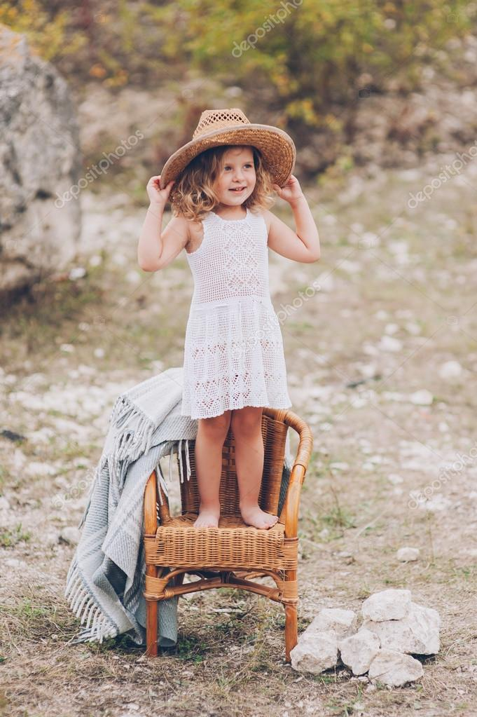happy little girl on a chair