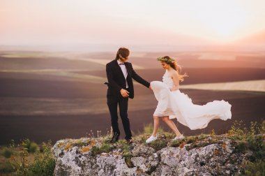 Wedding couple in moutains landscape