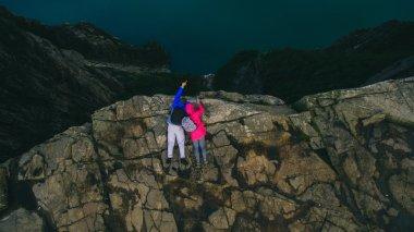 couple in love Preikestolen massive cliff