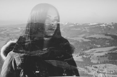 woman combined with photograph of snowy mountains