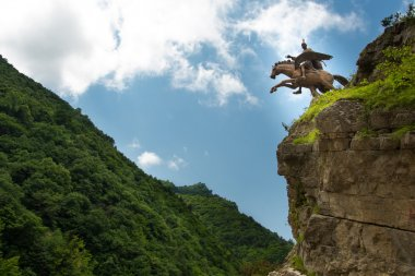 stone rider in the Caucasus mountains, Russia