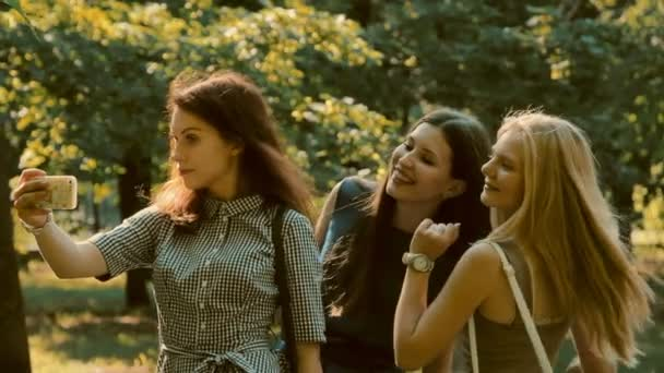 three girls walk photographed
