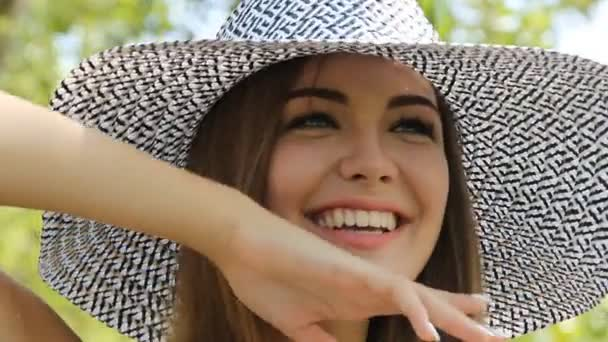 girl posing in a hat outdoors