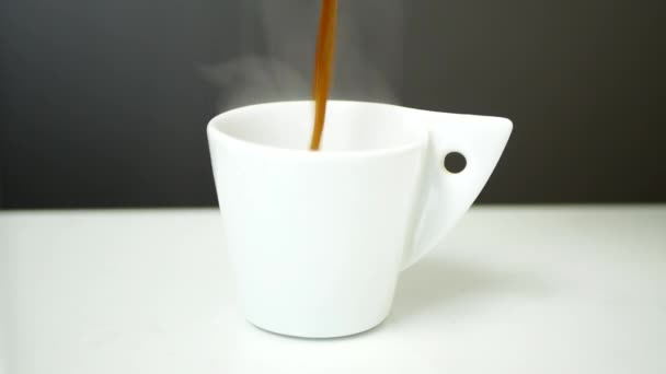 Filling a White Cup with Hot and Aromatic Fresh Coffee