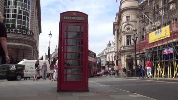 Old Traditional Red Public Phone Cab on the Street in London Downtown