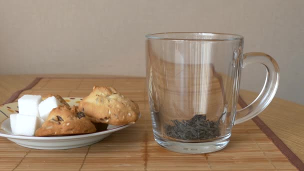 Pour black tea in a glass mug