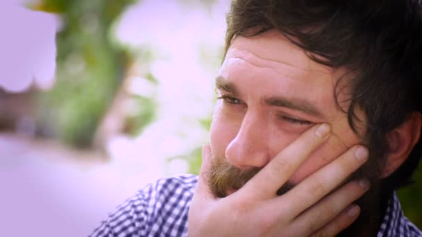 Portrait of a bearded man severely depressed and sad
